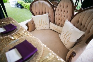 sweetheart-table-with-personalized-pillows-on-love-seat-with-gold-sequin-table-linen-purple-napkins