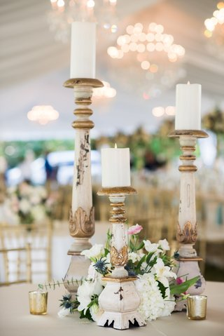 three-marble-candlesticks-of-varying-heights-at-wedding-reception