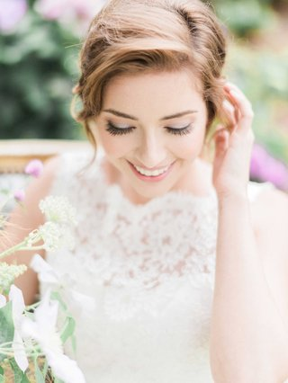 bride-with-ponytail-hairstyle-and-boat-neck-lace-wedding-dress-natural-makeup-long-eyelashes-lashes