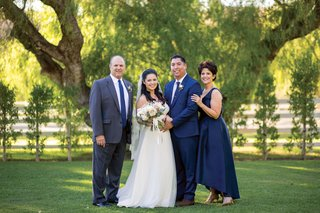 bride-in-watters-wedding-dress-interfaith-wedding-bride-and-groom-with-parents-of-the-bride