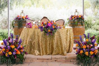 colorful-wedding-reception-decor-berry-tone-floral-arrangements-gold-sequin-table-linens-desert