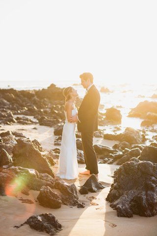 bride-in-j-mendel-wedding-dress-groom-in-ralph-lauren-purple-label-suit-golden-hour-portrait-maui