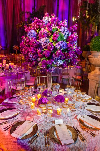 textured-linens-with-gilt-flatware-and-tall-floral-centerpiece