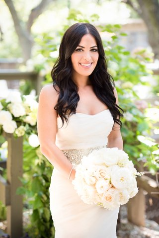 bride-in-vera-wang-and-wavy-hair-holds-garden-rose-white-bouquet