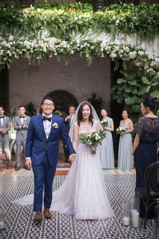 asian-bride-and-groom-wedding-inspiration-bride-in-berta-wedding-dress-groom-in-navy-suit