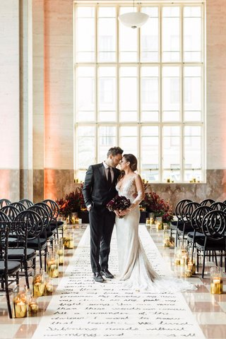 bride-in-ines-di-santo-wedding-dress-lace-illusion-long-sleeves-groom-in-suit-dark-calla-lily