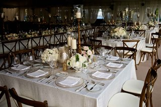 rustic-elegant-wedding-reception-table-with-candlestands-white-light-pink-roses-rustic-chairs