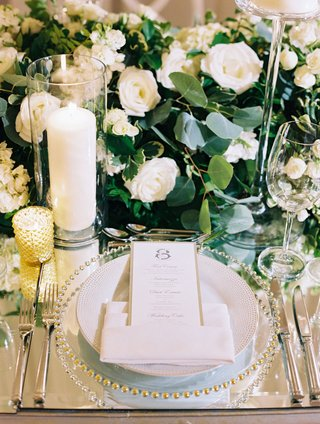 wedding-reception-mirror-table-top-with-greenery-and-white-flower-runner-candles-gold-candle-votive