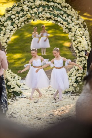 outdoor-wedding-ceremony-inspired-by-heaven-angels-ballerinas-ballet-dancers-on-flower-petal-aisle