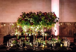 tall-gold-stand-for-floating-centerpiece-greenery-burgundy-oxblod-flowers-candlelight-taper