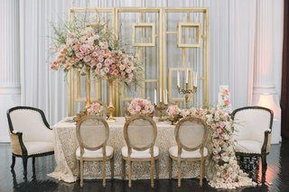 taupe-tablescape-with-embroidered-linen-cascading-floral-runner-made-up-of-pink-roses-gold-detailing