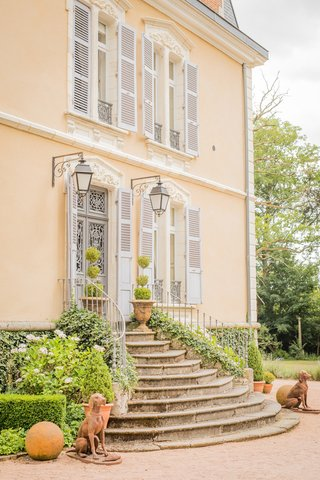 villa-bed-and-breakfast-home-in-france-stairway-sconces-pretty-destination-wedding-venue