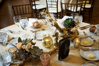 round-wedding-table-with-rustic-centerpiece-featuring-gold-branch-succulent-antique-color-flowers