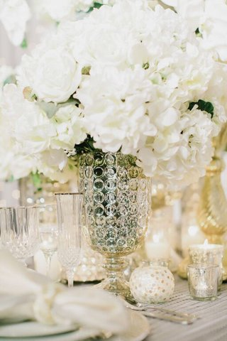 mercury-glass-vase-with-white-flowers-at-winter-wedding-reception