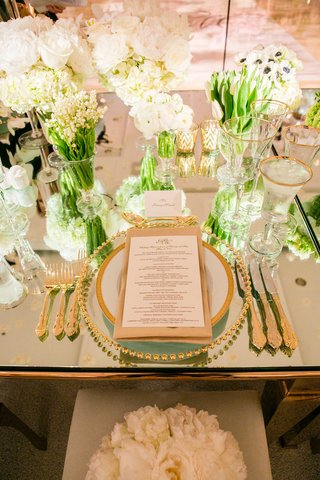 wedding-reception-mirror-top-table-gold-flatware-gold-charger-white-rose-peony-tulip-lily-flower