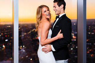 bride-in-strapless-lazaro-corset-dress-groom-in-black-jacket-and-grey-pants-dtla-sunset