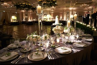 floral-and-foliage-chandeliers-with-candles-and-tall-candlesticks-ivory-flowers-on-tables-live-band
