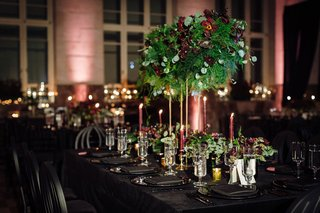 reception-with-dark-velvet-linens-black-charger-black-napkin-black-chair-tall-centerpiece