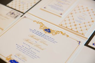 white-cards-with-gold-and-royal-blue-letterin