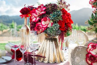 red-and-white-flower-floral-arrangement-in-gold-vase-pink-table-linen-vineyard