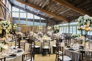 calamigos-ranch-redwood-room-reception-rustic-wood-ceiling-white-and-green-centerpieces