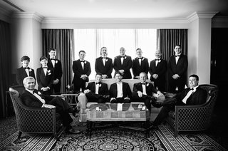 black-and-white-photo-of-groom-and-groomsmen-in-hotel-room-in-chicago-before-wedding