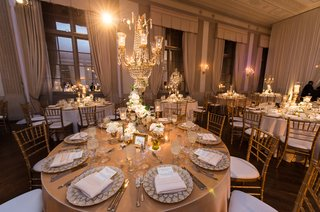 crystal-chandelier-with-white-florals-on-metallic-tablescape