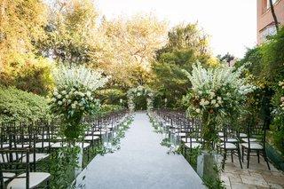 hotel-bel-air-outdoor-wedding-ceremony-greenery-white-flowers-white-aisle-runner