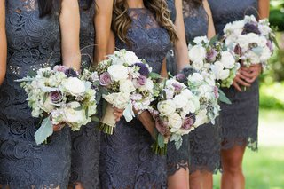 bridesmaids-in-short-lace-dresses-with-garden-flowers