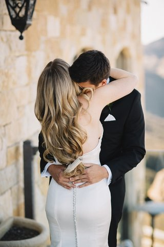 bride-in-strapless-romona-keveza-wedding-dress-with-sweetheart-neckline-hugs-groom-hugo-boss-tuxedo