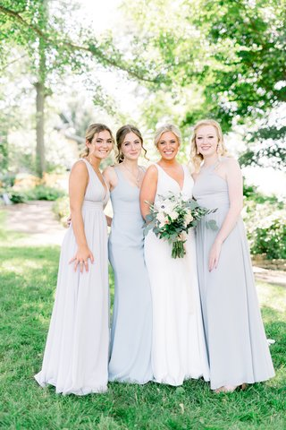 bride-in-crepe-silk-sllure-gown-bridesmaids-in-very-pale-blue-dress