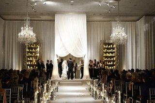 bride-and-groom-married-beneath-white-chuppah