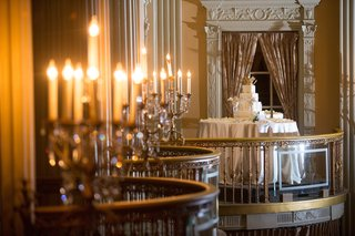 white-wedding-cake-on-a-ballroom-balcony-of-the-millennium-biltmore-hotel-los-angeles