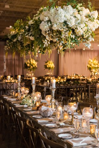 floral-chandelier-with-tall-and-short-candles-wedding-reception-decor