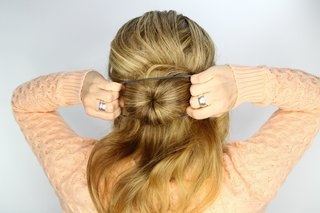bride-doing-sock-donut-bun-with-hair-tie