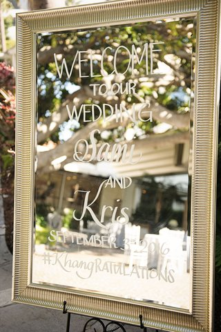 wedding-ceremony-welcome-sign-on-mirror-frame-easel-at-outdoor-wedding-santa-monica-fairmont-bungalo