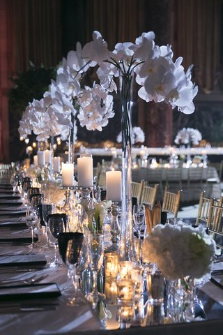 wedding-reception-table-with-mirror-runner-white-orchids-calla-lilies-candles-at-cipriani-wall-st