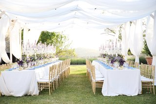 destination-wedding-in-tuscandy-two-kings-tables-drapery-above