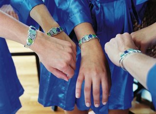 bridesmaids-in-blue-dresses-with-colorful-bracelet-cuffs