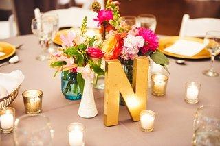 gold-letter-n-and-low-pink-floral-arrangements