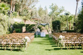 wedding-ceremony-wood-vineyard-chairs-grass-lawn-houdini-estate-chuppah-pampas-grass-palm-trees