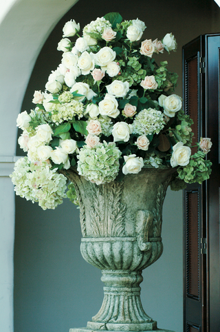 roses-and-hydrangeas-in-stone-urn-vessel