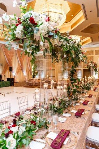 wedding-reception-long-head-table-dance-floor-burgundy-flowers-napkin-greenery-nuage-designs-linens