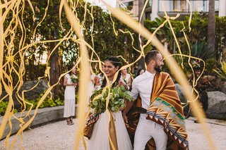 native-american-latina-bride-in-bhldn-chumash-ceremony-blanket-streamers-for-recessional