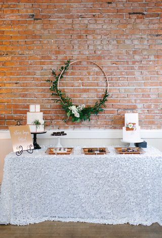 a-dessert-table-textured-white-table-linen-copper-signage-white-cakes-hoop-greenery-geometric-shapes