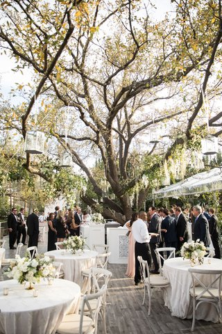 wedding-reception-at-bride-family-home-tree-wood-floor-neutral-decor-spanish-tile-bar-motif