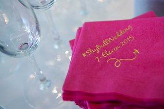 a-couples-wedding-hashtag-a-fun-play-on-their-new-shared-last-name-gold-calligraphy-hot-pink-napkins