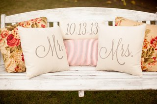floral-pillows-and-wedding-date-pillow-on-bench