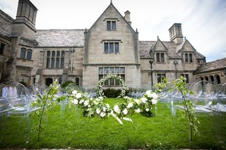 wedding-ceremony-on-grass-lawn-mansion-in-pittsburgh-pennsylvania-grey-stone