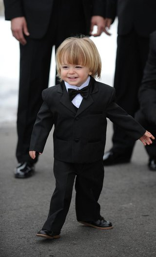 young-blond-ringbearer-in-black-tux-with-bow-tie
